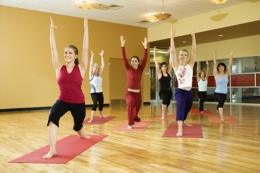 Adult females in yoga class