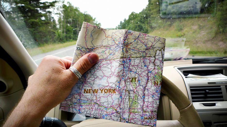 man looking at NY map
