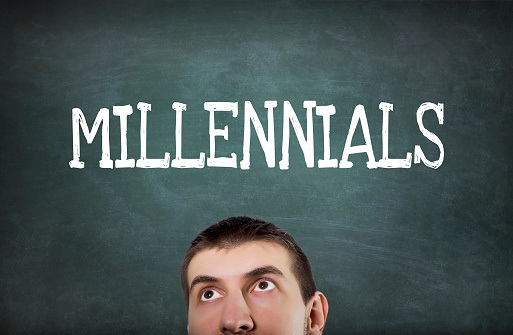 man looking up at millenials sign